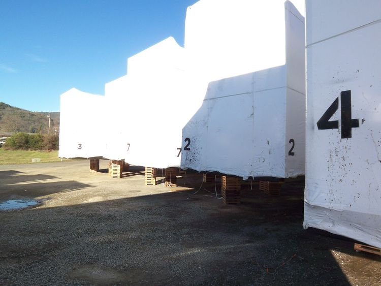 Here's a view of the shrink-wrapped modules staged at the airport, after being removed from the ten semi trucks that brought them up from Los Angeles.