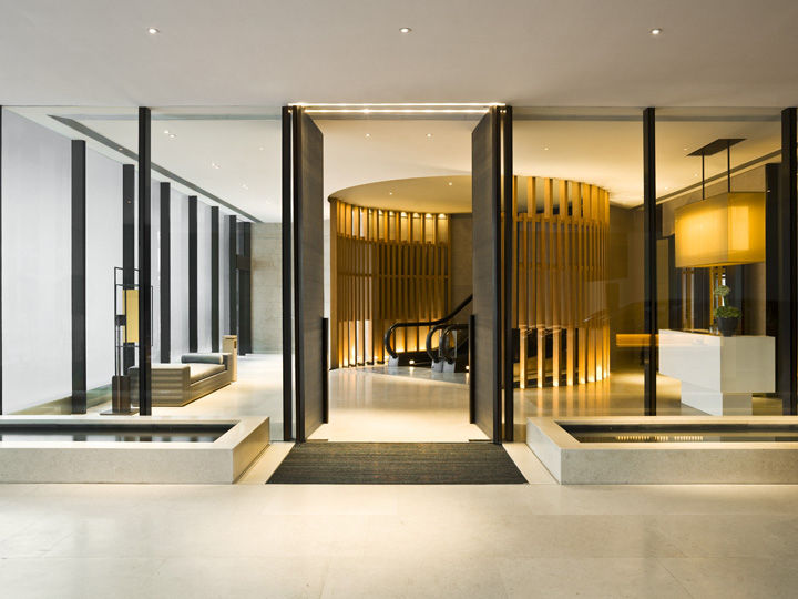 """Since the hotel starts higher up in the hotel, the approach at street-level is understated, with just a small entry lobby tucked into a corner of the highrise footprint. Fu's inspiration for the hotel was a """"modern-Oriental residence, designed with respec"""