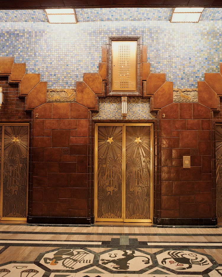 Lavish tile treatment and intricately-etched elevator doors are found inside the Art Deco Marine Building.