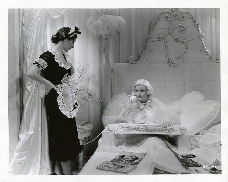 """Jean Harlow, with her signature platinum hair, fit right into the all-white set design of the 1938 film <em>Dinner At Eight</em>. From the book: """"[Streamlined Moderne] would not have been feasible if it had not been for the development of incandescent lig"""