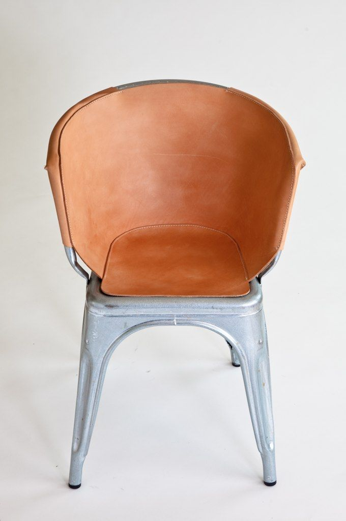 "And here it is spiffed up and softened with a fitted vegetable-tanned leather cover, which will age and patina beautifully over time. ""It reflects and highlights the chairs ingenious method of production, whilst giving it a suitable indoor application,"" s"