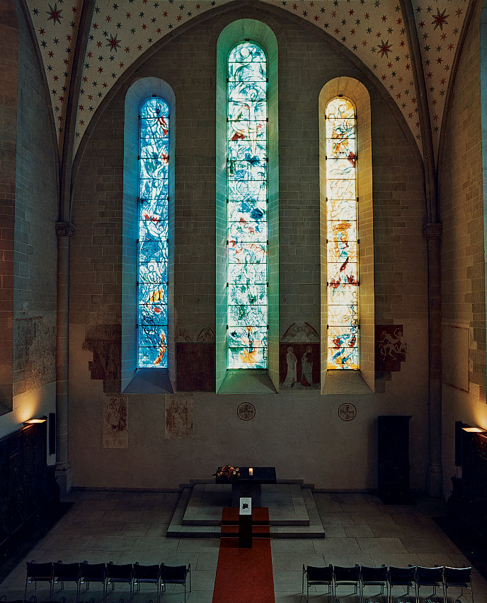 Stained-glass windows by Marc Chagall illuminate the choir at Fraumünster Church.