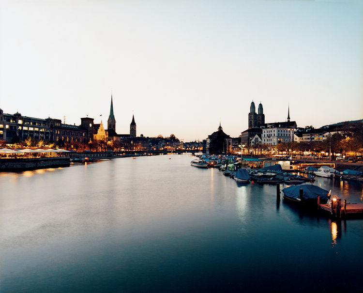 Flowing out of Lake Zurich through the Old Town—–and dividing the iconic Fraumünster and Grossmünster churches—–the Limmat River has figured centrally in Zurich life for centuries. Today, restaurants and bathhouses line its banks, and swimmers and boaters