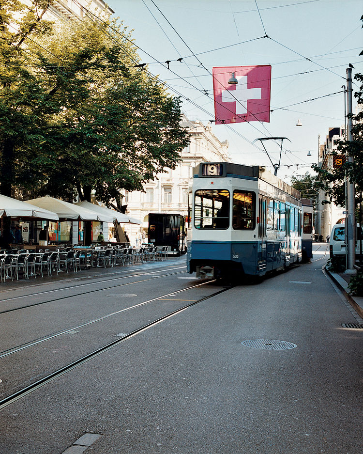 A tram rumbles down Bahnhofstrasse, a popular and tony shopping district where private banks, watch stores, boutiques, and chocolatiers line the renowned thoroughfare.