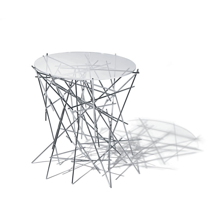 Designers Fernando and Humbert Campana conceived this prism-like table in 2004 for Alessi using a collection of welded stainless steel rods to create the base. The tiny table is but one piece in their Blow Up collection, which also includes accessories su