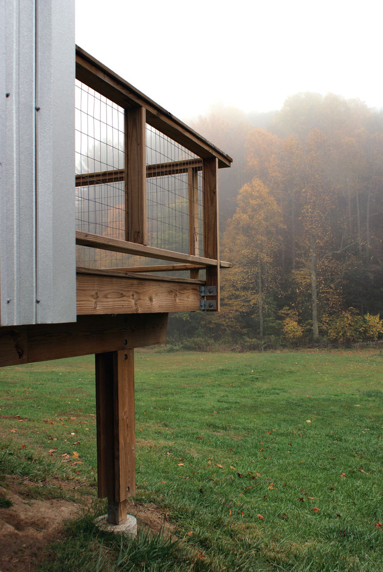 An off-the-shelf post and beam system is used as foundation for the porches.  Welded wire mesh is used for the guardrail.