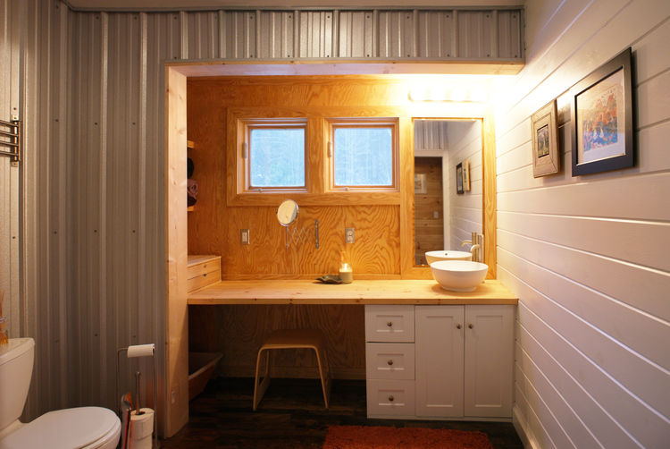 """The vanity in the bath is housed in what Everhart calls a """"bump-out"""" or saddlebag that expands interior space by a few feet on either side of the farmhouse."""