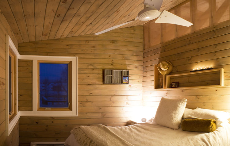 The corner window in the bedroom frames the view of one of three creeks and streams surrounding the two and a half-acre site.