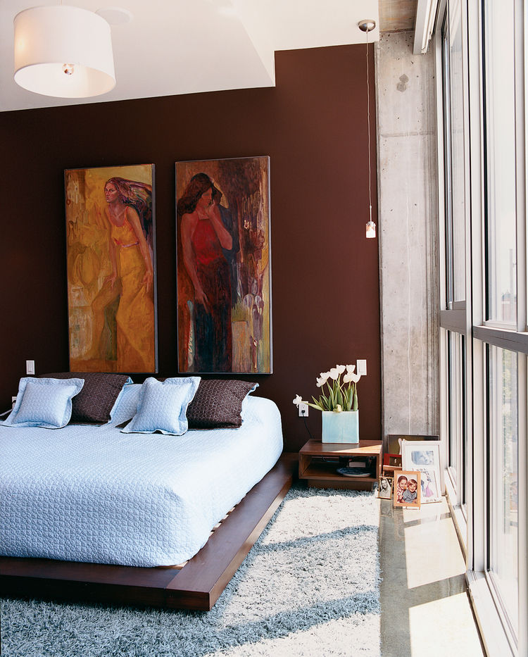 """The bedroom. The addition of the couple's art collection """"has really given [the color] purpose,"""" says Julie Gibson."""
