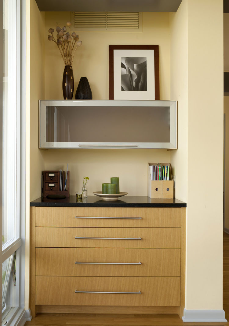 "Just inside the patio doors and near the dining table is Braitmayer's work nook. The top drawer flips out to become a desk; the top cabinet slides straight up to reveal more storage. ""It's very organized,"" says Sundstrom."