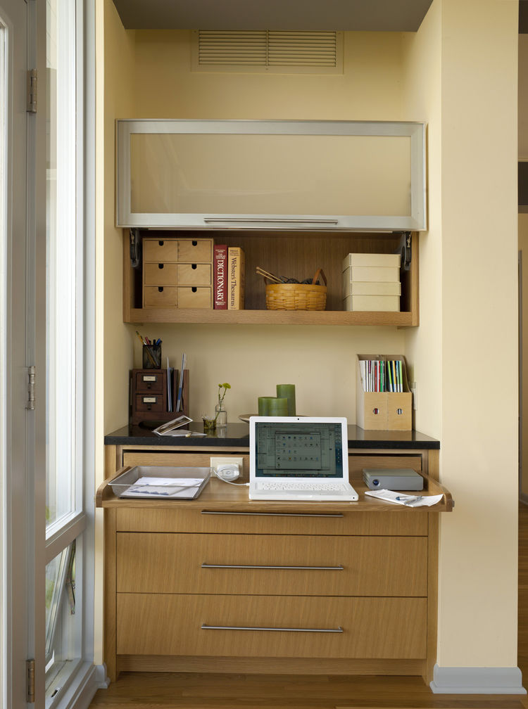"The workstation, open. ""This was our solution to providing Karen with a place to work at home,"" says Sundstrom. ""She used to work in the bedroom, but we cut the room down considerably, and we thought it would be best to keep the bedroom as a place to rela"