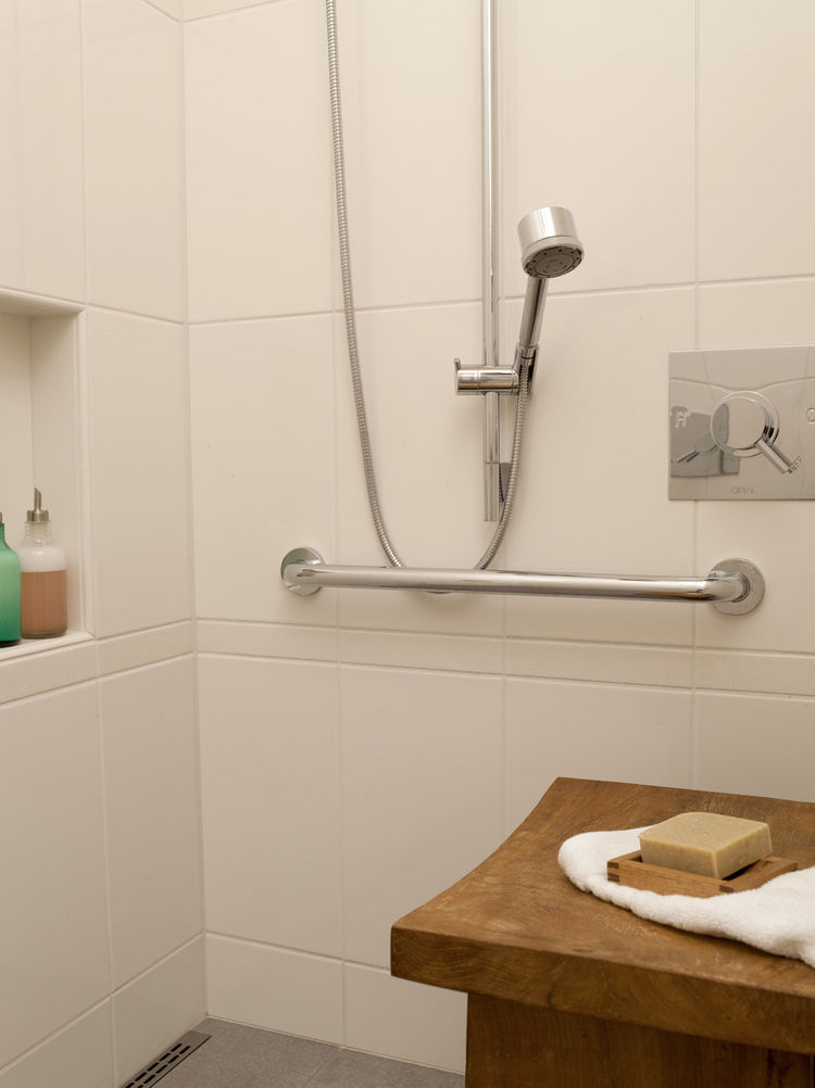 The shower can accommodate two, and has Hansgrohe heads of differing heights with separate controls from Cifial. The residents stayed away from a built-in bench and opted to switch out a variety of tables and benches as needed, to avoid dealing with the m