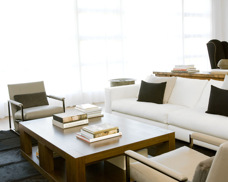 "<p>Hollis outfitted the living room with a sofa and lounge chairs from <a href=""http://www.minotti.it"">Minotti</a>, a coffee table from <a href=""http://www.hollyhunt.com"">Holly Hunt</a>, and custom built-in bookcases (see previous photo) by <a href=""http:"