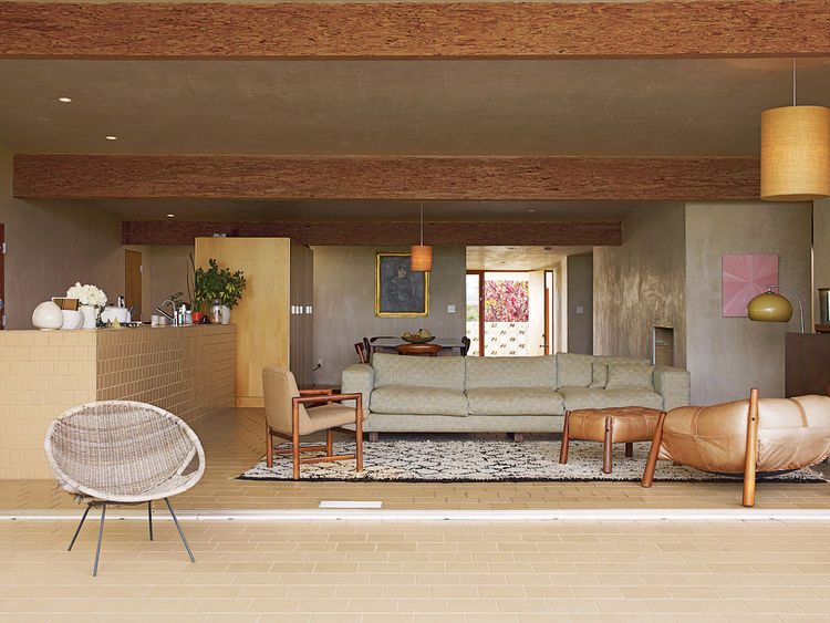 Pearson and Trent furnished the house with lamps and chairs they culled from vintage stores in the area. They found the overstuffed leather lounger at Surfing Cowboys in Venice. The couple and the architects collaborated on the couch design and had it fab