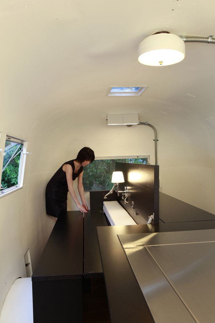 picnic-style table in renovated Airstream trailer