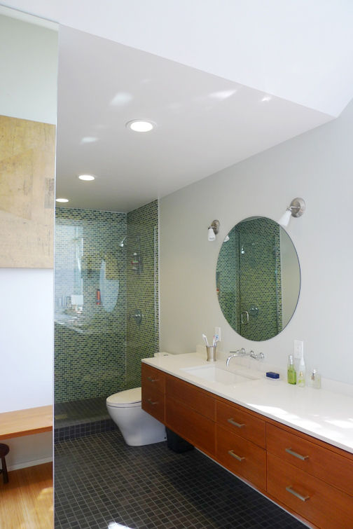 The view toward the shower space; the vanity runs the nearly the entire length of the wall.