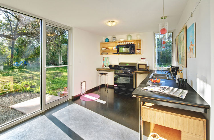 "When planning the house as a single man, Wong asked for a ""bachelor's kitchen,"" noting that he could only make frozen pizza and sandwiches. The simple setup, which faces East and receives the bright morning sun, still accommodates the family well. The lit"