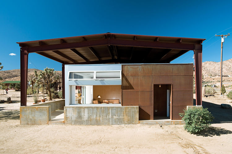 The rustic look of surfwear entrepreneur Jim Austin's home both stands out and also conforms with its rough-and-tumble surroundings in Pioneertown, California. Photo by David Harrison.