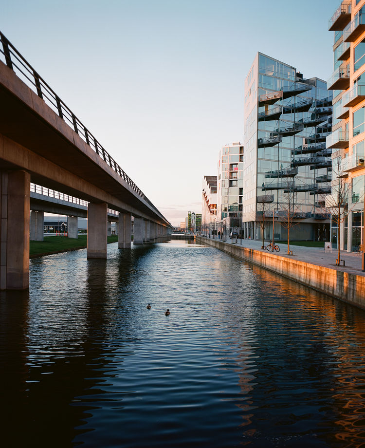 "The challenge of building in Ørestad is that the area lacks human scale and urban elements, save the Metro stop. ""When you build where there's absolutely nothing, you can't expect too much from your surroundings,"" Ingels says. ""You essentially have to cre"