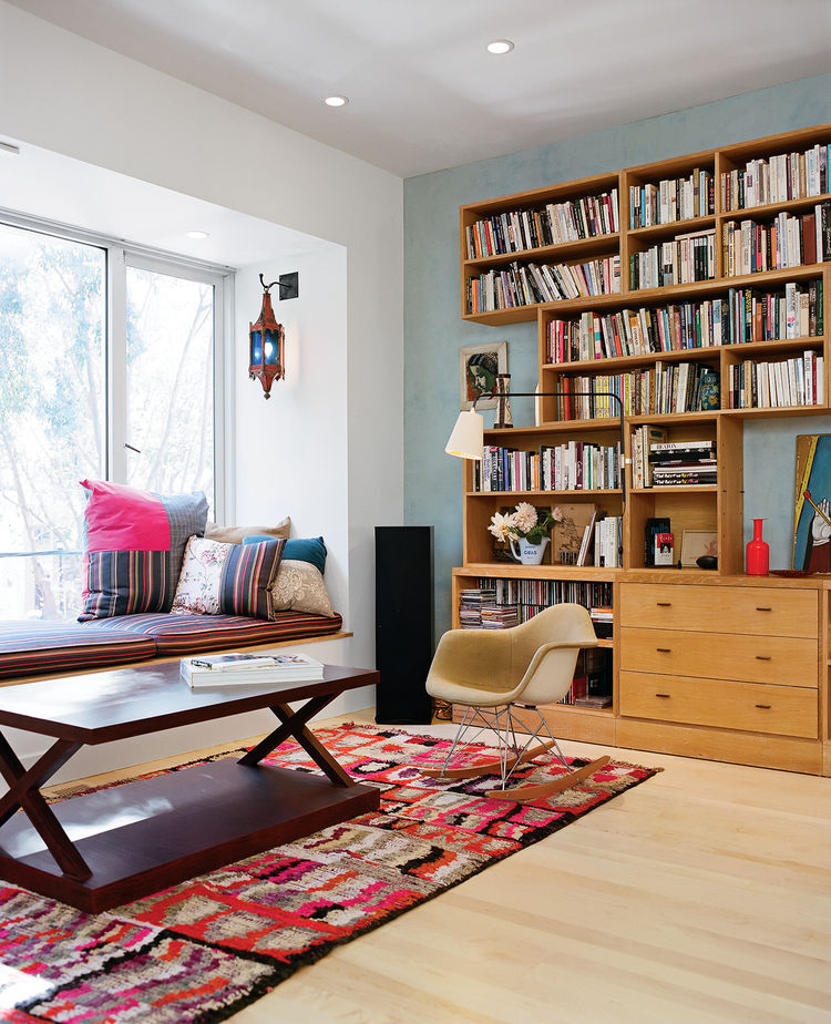 The living room is a mélange of vintage Moroccana, a Philip Agee coffee table, the Eames rocker in which Michael was nursed as a tike, and a window seat whose fabric is Paul Smith Stripes for Maharam.