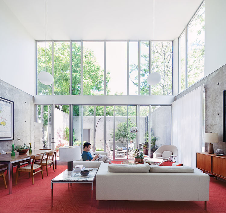 A loveseat and two Neo arm chairs by Niels Bendtsen in the living room offer Blauvelt a light-filled view to the courtyard beyond.