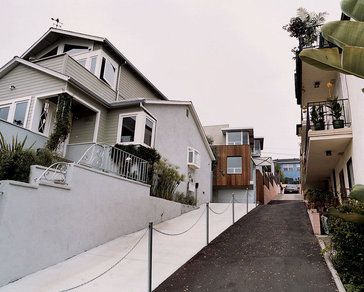 """The restored original and new addition. After a brief tussle over access to their shared driveway (resulting in what Bornstein calls a """"spite fence""""), most of the occupants in the apartment building next door appreciate having a family as neighbors, rathe"""