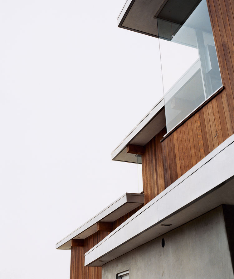 """Galvanized-aluminum flashing is used to hide lighting fixtures and to delineate the tops of the redwood-strip walls. """"It's a simple palette of materials,"""" says architect Jesse Bornstein."""