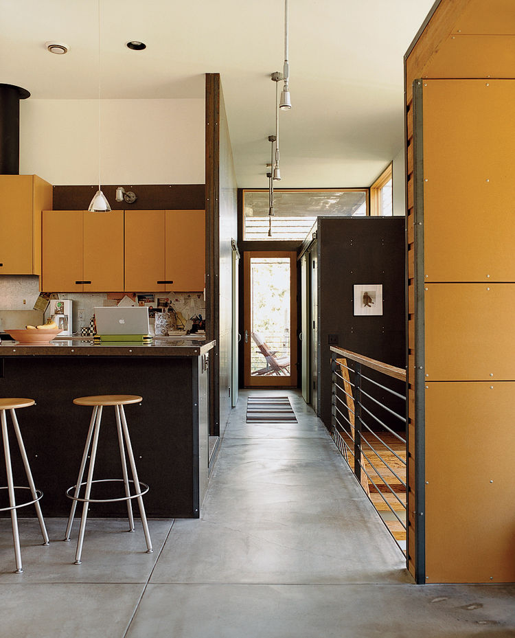 Oiled concrete floors inform the interior of the Stanwood residence.