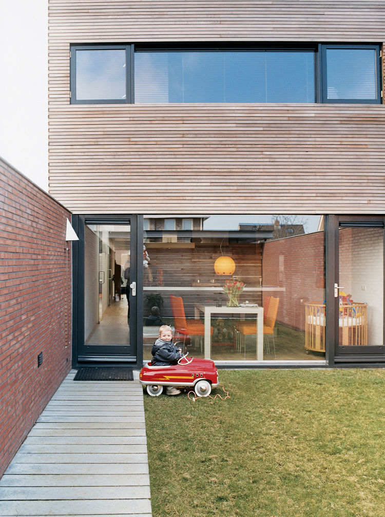 Because the Collette residence, although by no means small by Dutch standards, is a compact 2,050 square feet, the inside/outside relationship is important. Glass walls front and back bring the outdoors in. Two-year-old Jort takes full advantage of the gr