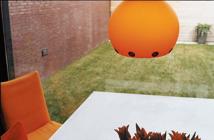 "The pumpkin-orange Dordoni Halloween lamp is both UFO- and sun-like—a slightly humorous and cheering sight on a gray day in Holland. It was chosen, says Dedy, ""simply because it says 'welcome home.'"""