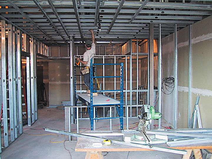 Working within an empty shell, the design had to accommodate plumbing fixtures and existing concrete floors and ceilings.