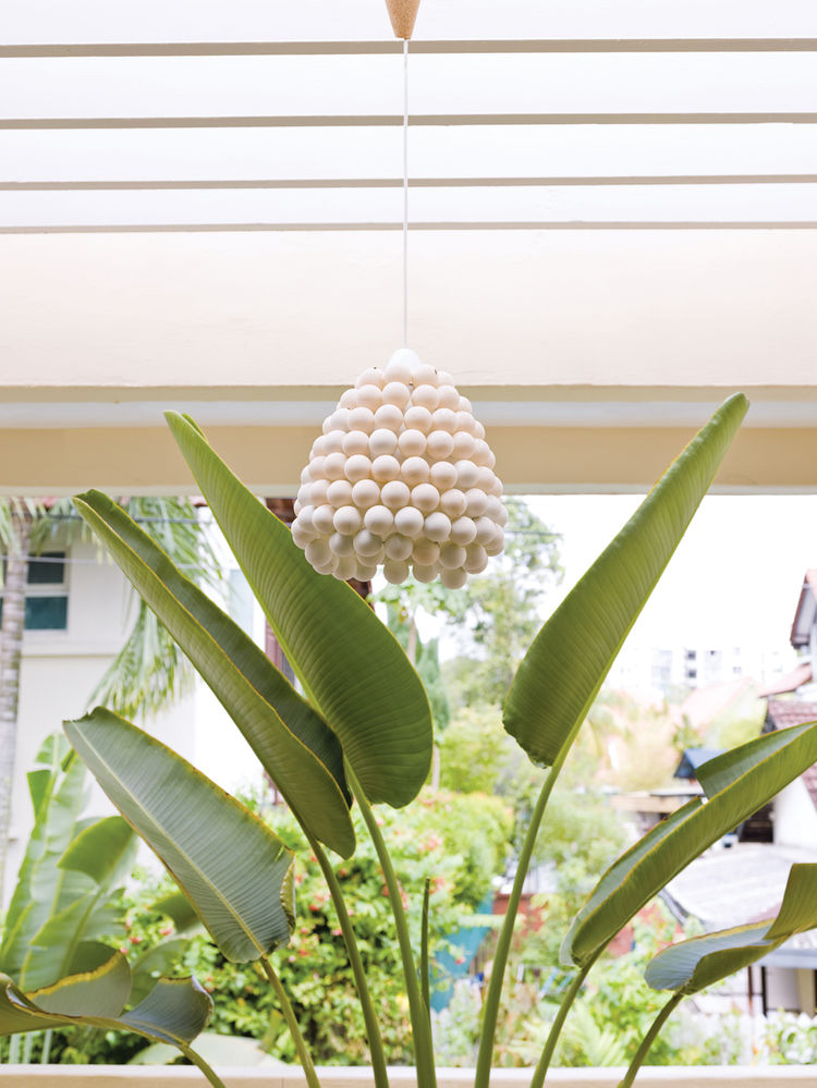 "One of the first things De Waart did when they moved in was to remove  all the curtains—–save those on the bedroom windows—–and change the lighting fixtures. ""A nice lamp can add so much extra to a room,"" she says. De Waart favors organic shapes, like the"