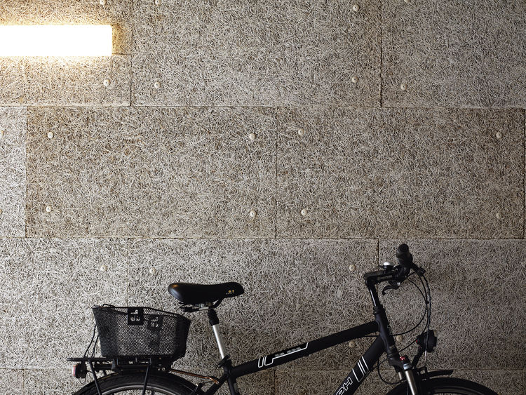 The lobby-cum-garage plays home to the couple's favorite forms of transport:  a bike and Spiekermann's Audi.