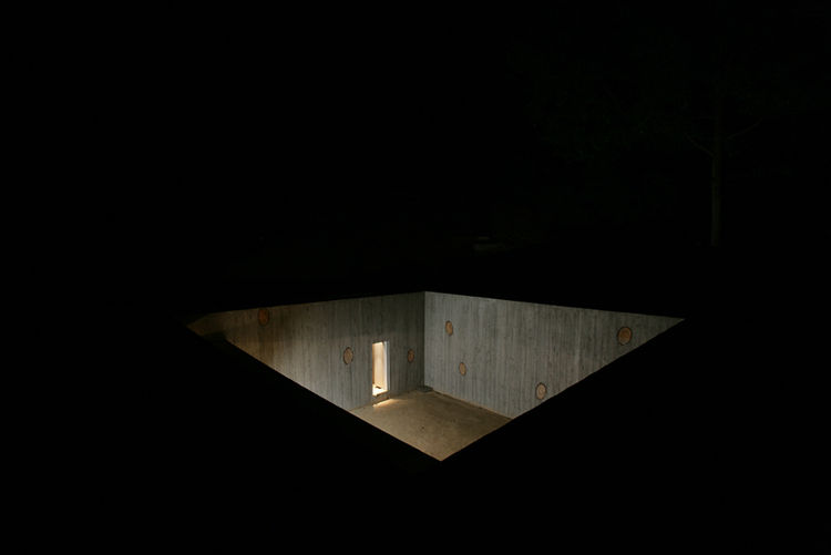 The floor of the courtyard is made of rammed earth from the building site, as are the walls and floors of the interior. All doors, including this one leading to the stairway, are about four feet high.