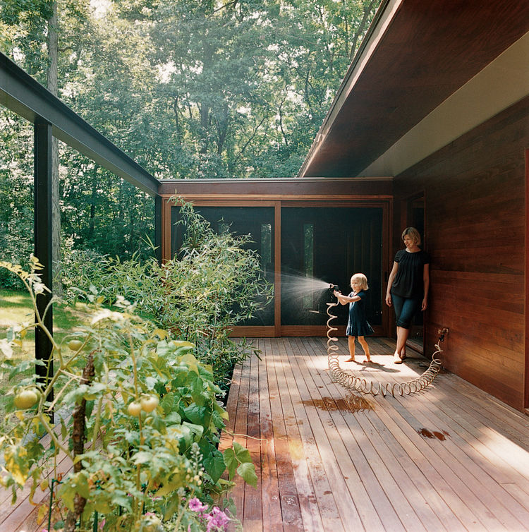 The main area opens onto the back deck for a seamless transition between house and surroundings.