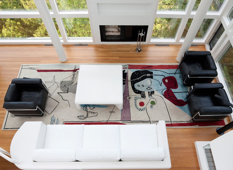 An aerial view of the living room of the Douglas House featuring a custom sofa and low table designed by Meier and an Edward Fields rug