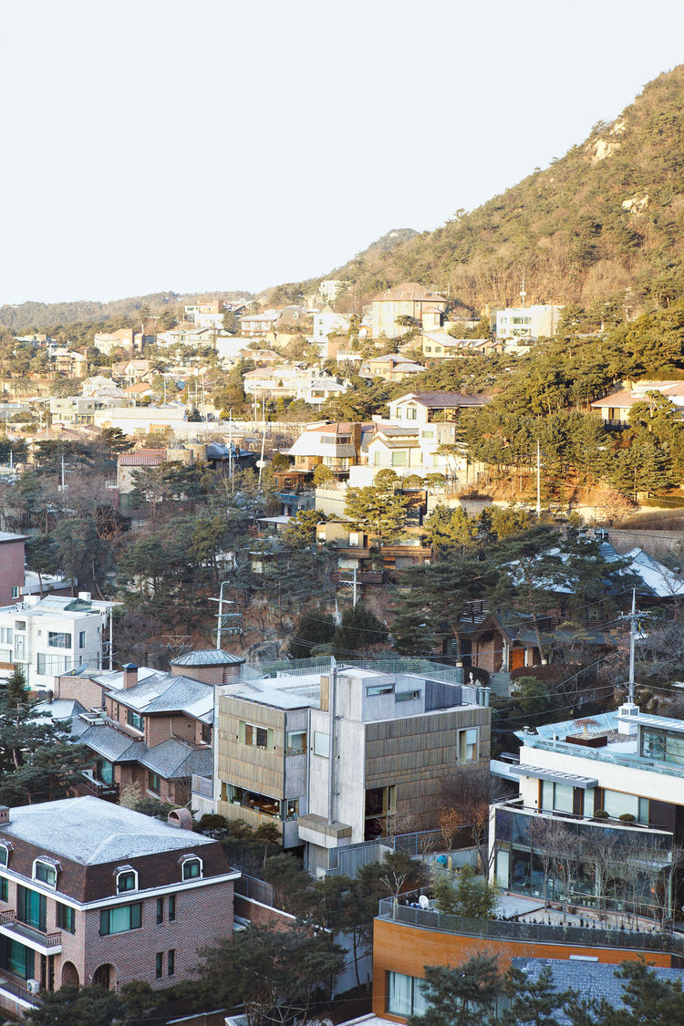 Four Box House perches on a rugged mountain-side in northern Seoul's Pyeongchandong district, making for spectacular views.
