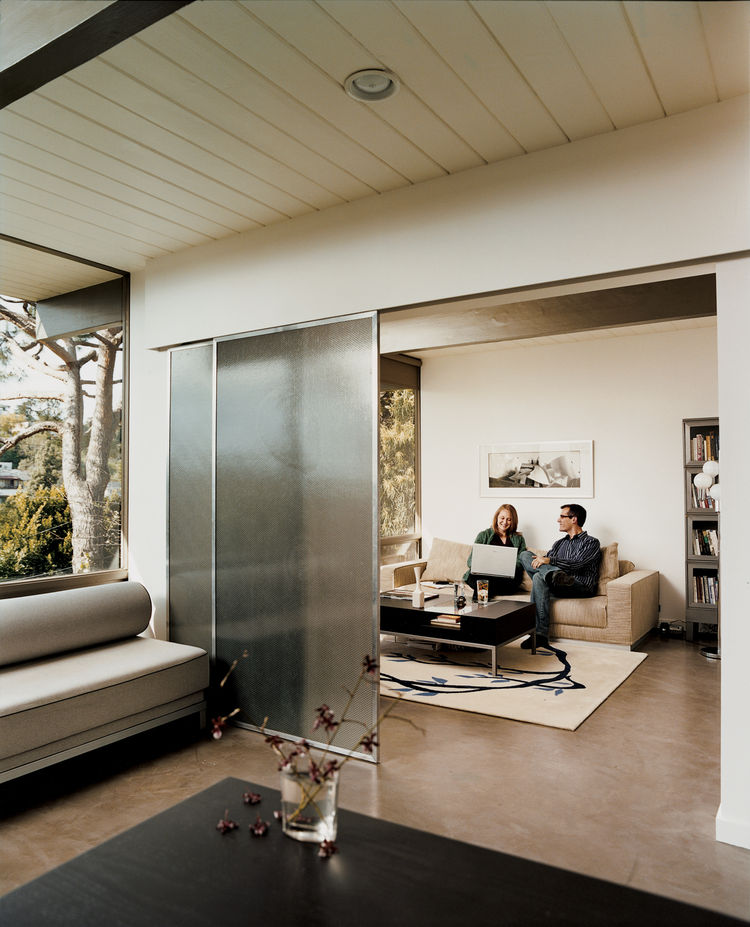 Garcetti and Wakeland enjoy a quiet afternoon, sitting in what used to be two separate bedrooms. By removing a wall, the space now serves as an office and den, divided only by sliding doors.