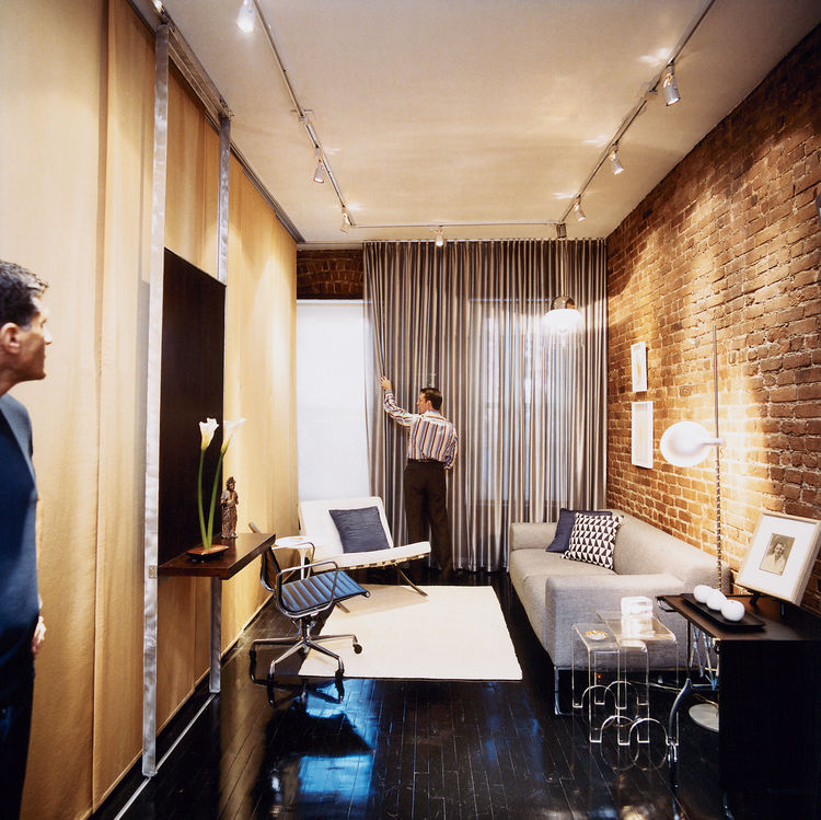 Milan Hughston's quiet street in Manhattan's West Village is moments from the neighborhood's boutique shopping and nocturnal ruckuses. Architect Joel Sanders made Hughston's space multi-functional; here it's shown as a living room, for relaxing or enterta