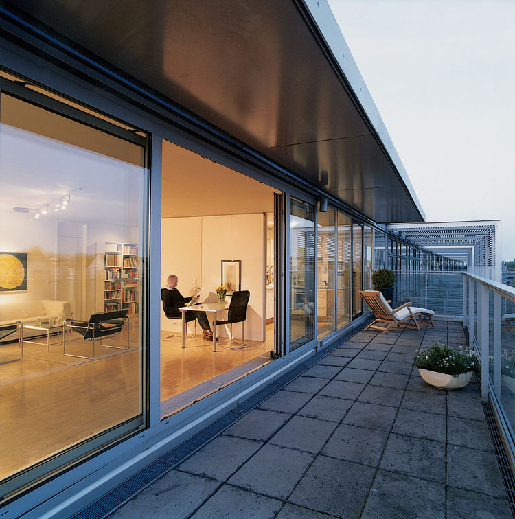 Wall-to-ceiling glass panels on the two exterior walls maximize the views and flood the apartment with light. The interior wall panels can be entirely removed to create a single loft space.