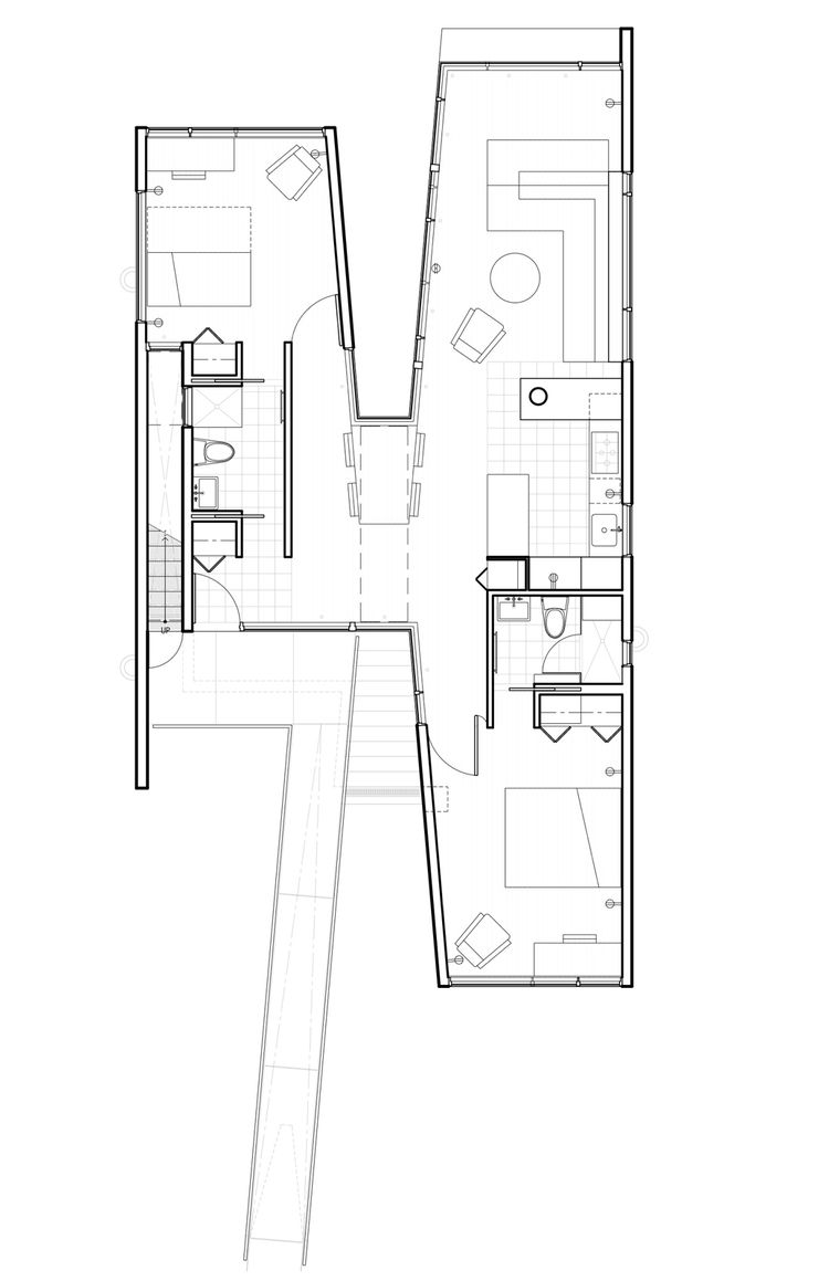 "The architect designed the building in an X formation, with two main modular structures united by a passageway. The living and sleeping areas were placed at opposite ends of the space to allow for privacy and ""to allow the children to continue their auton"