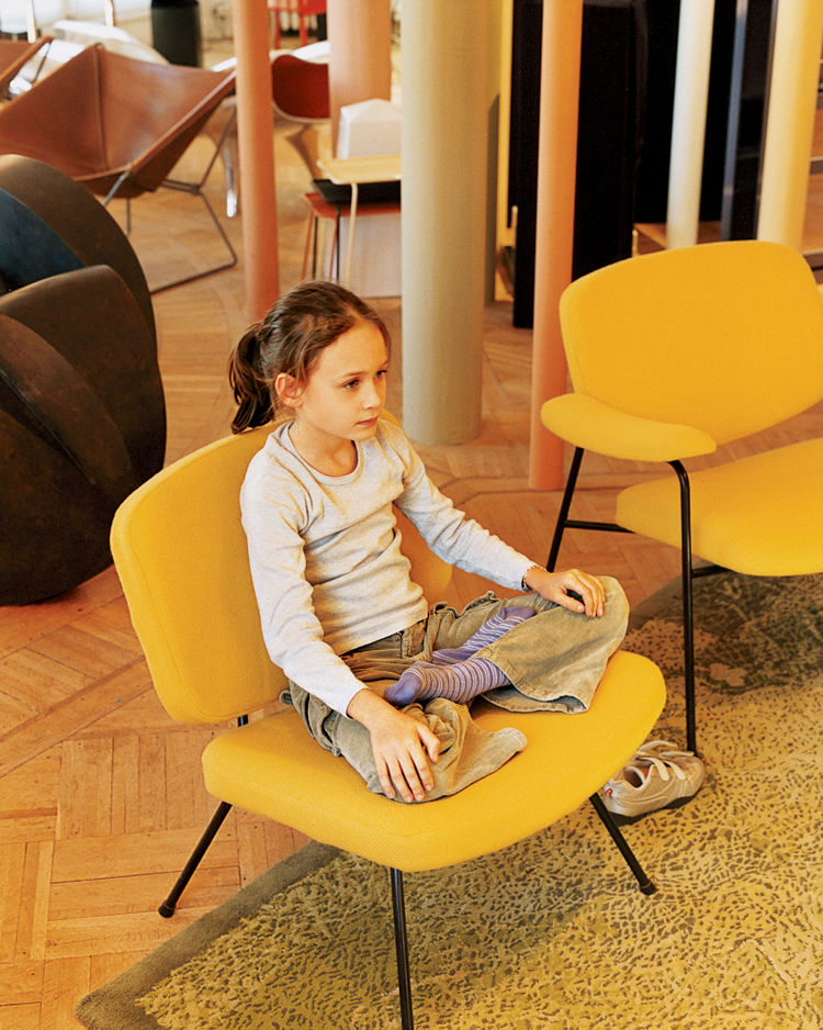 Clara strikes a yoga pose on a vintage Pierre Paulin chair for Artefort.