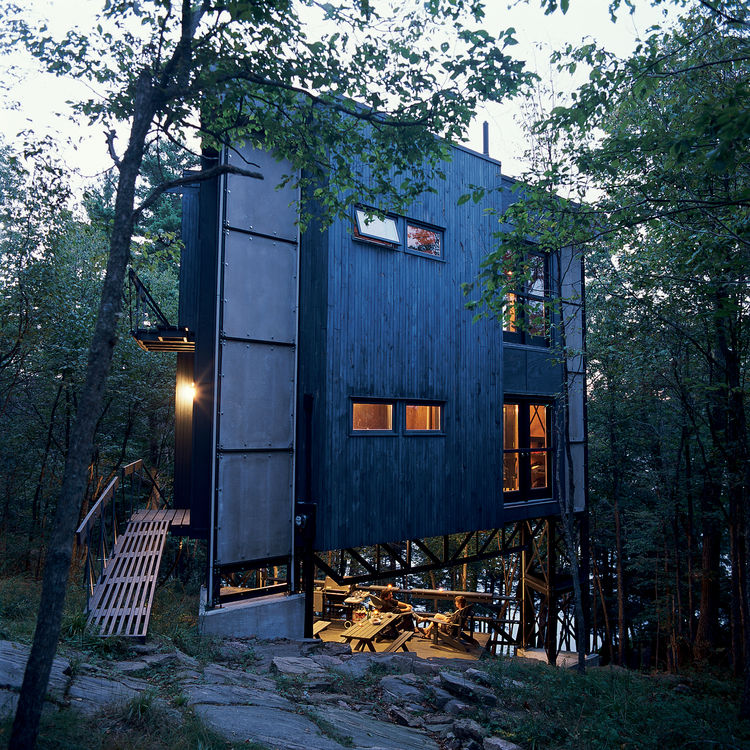 Playfully christened La Tour des Bébelles, architects André Lessard and Barbara Dewhirst's three-story, steel-framed tower has shown itself to be the ideal summer retreat: secluded, perfectly positioned near Ontario's Otter Lake, and encouraging of its in
