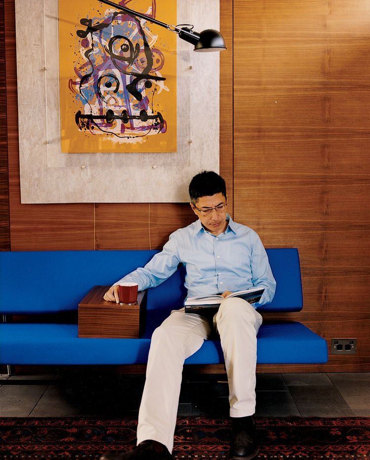 Langston-Jones created a custom armrest that he had made to fit snugly on his blue Slaapbank sofa designed by Martin Vissin.