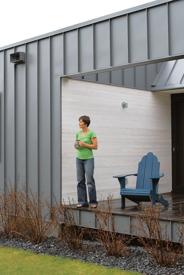 The back deck of the Leiniche Navitsky residence featuring standing-seam metal siding.