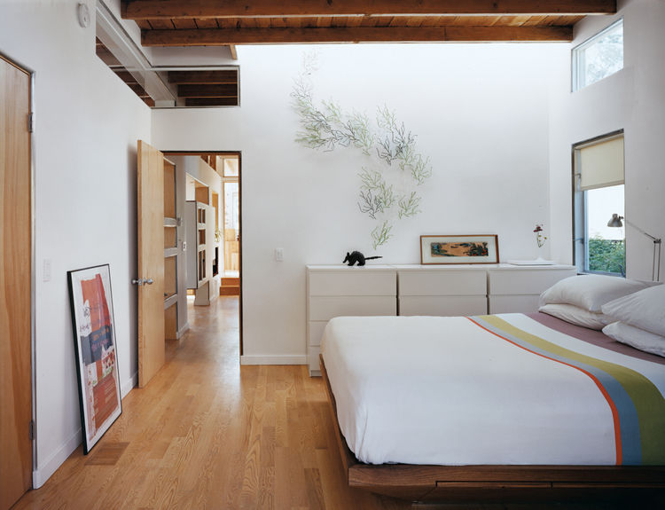 The front bedroom reveals how the design creates through-flow of light and air in what had previously been a poky set of spaces.