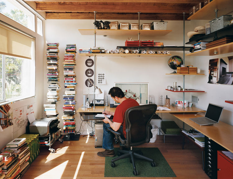 A preoccupation for Levine was saving space and money; he and his team used threaded steel rods and birch veneer plywood to construct the shelving in his office at the rear of the house.