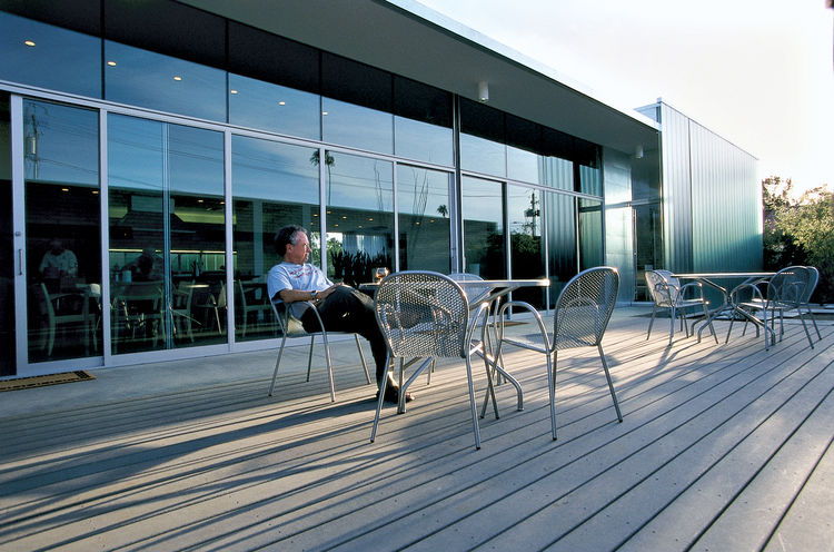 Ronde outdoor stacking chairs, from Design Within Reach, are situated on the deck off the living room.
