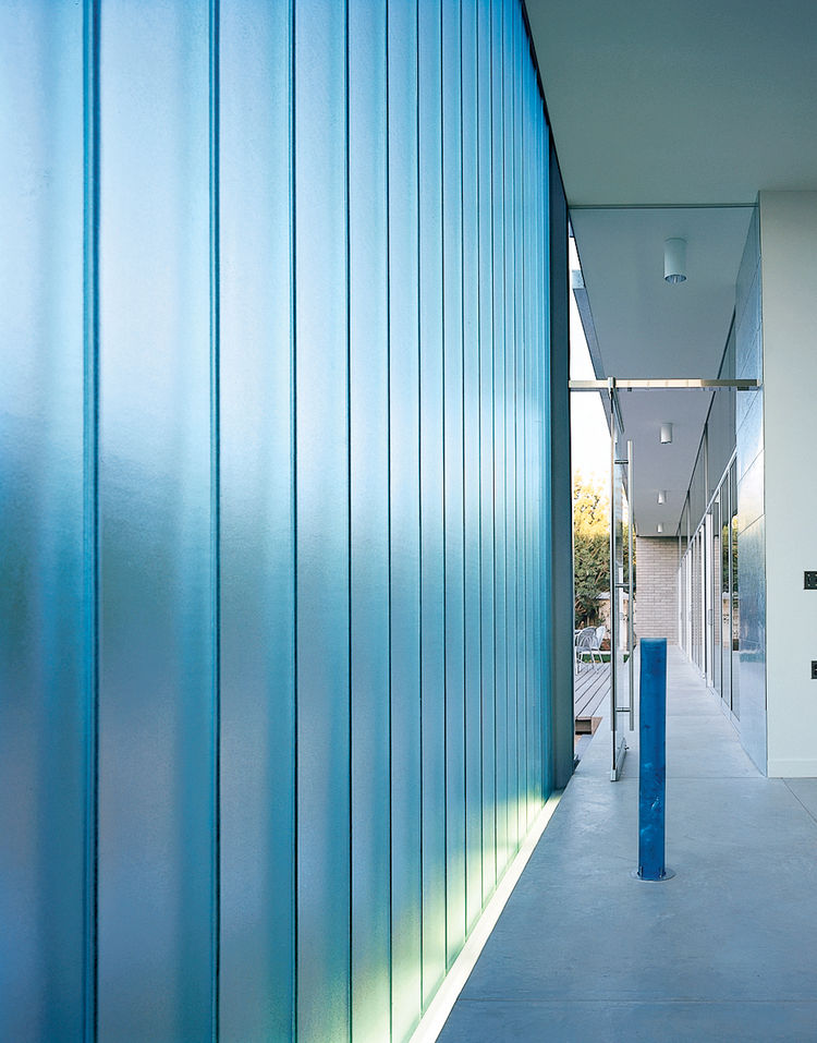 Walls of channel glass, an industrial material that comes in long strips shaped in a shallow U, help preserve the residents' privacy, while allowing only soft, filtered light inside. In the chapel, the DeBartolos paired and staggered the narrow panels so