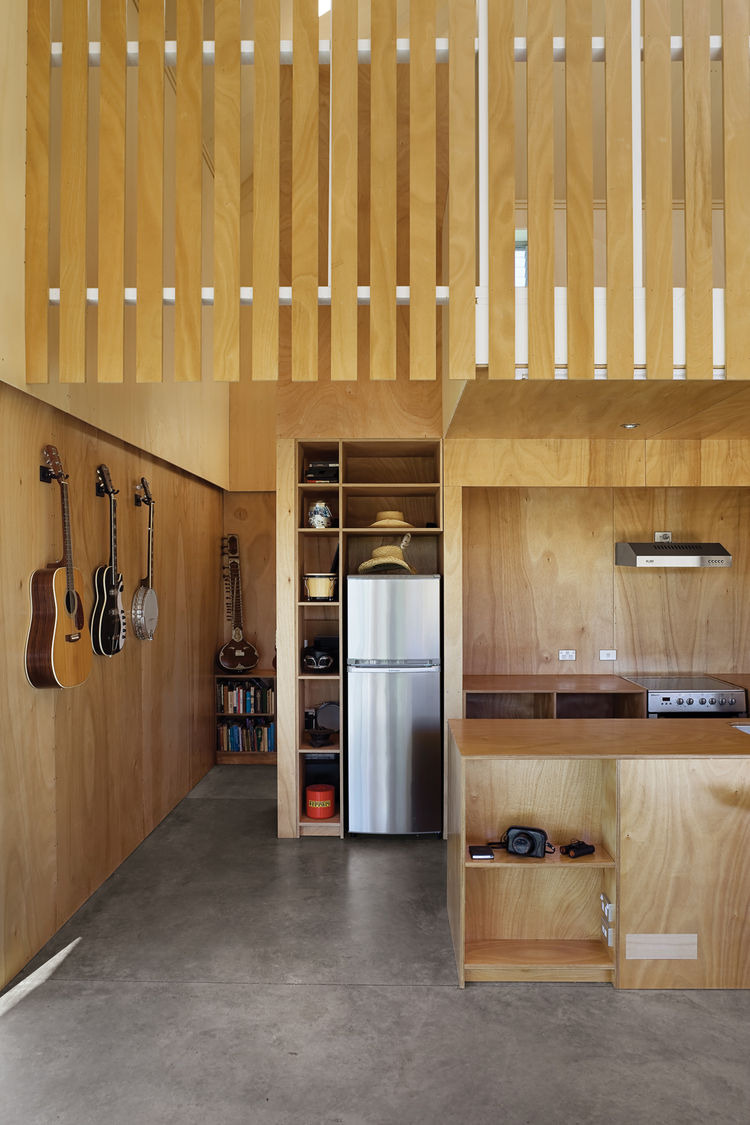 The kitchen is small but utilizes all available space—even allowing room for a hat or two.